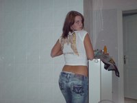 Girls in tight blue jeans erotically bending over from Upskirt Collection