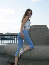 Blue fitting jeans of this girl sexily wrap her slim hips from Upskirt Collection