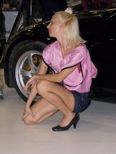 Blonde in pink top and black shorts shot near the car from Upskirt Collection