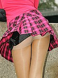Tan hose tightly hold pantieless chick?s ass and pussy from Upskirt Collection