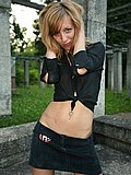 Lewd gal in black outfit sexily poses and shows upskirt from Upskirt Collection