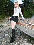 Slim doll in high boots spreads to show fat pussy lips from Upskirt Collection