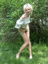 Blonde chick performs in the amateur photo session from Upskirt Collection