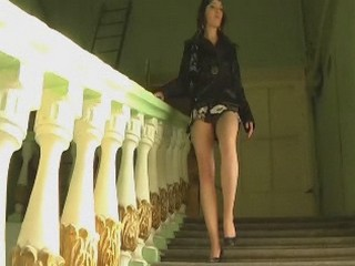 Saucy bimbo?s hot upskirt short as she walks downstairs from Upskirt Collection