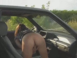 Nasty bimbo bends over in car and rubs clit with fingers from Upskirt Collection