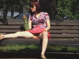 Hidden upskirt video of amateur girl relaxing on the bench from Upskirt Collection